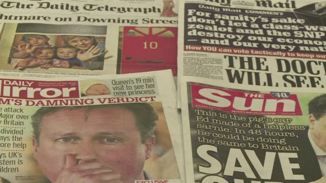 uk papers are full of politics on the last day of campaigning for the most unpredictable election in living memory which could yield no clear winner... - politics and government stock videos & royalty-free footage
