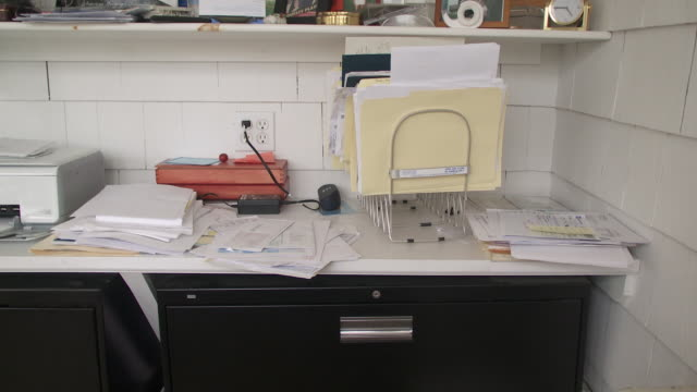 cu papers on desk in home office, scarborough, new york, usa - disordinato video stock e b–roll