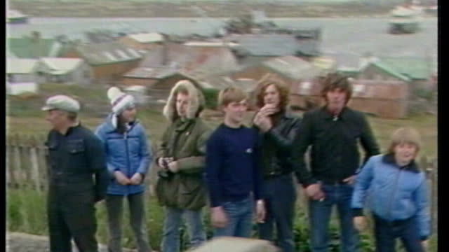 papers reveal division in government over falklands war cutaways people lining streets and waving after british forces retook the falkland islands - politics and government stock videos & royalty-free footage