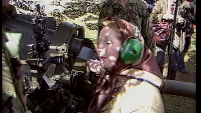 papers reveal division in government over falklands war falkland thatcher wearing headscarf and ear protectors firing artillery gun thatcher sat... - ear protectors stock videos and b-roll footage