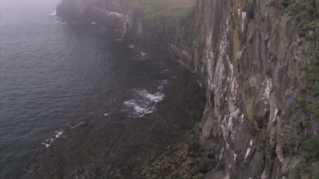 papey island. basalt cliff face over the ocean. - basalt stock videos & royalty-free footage