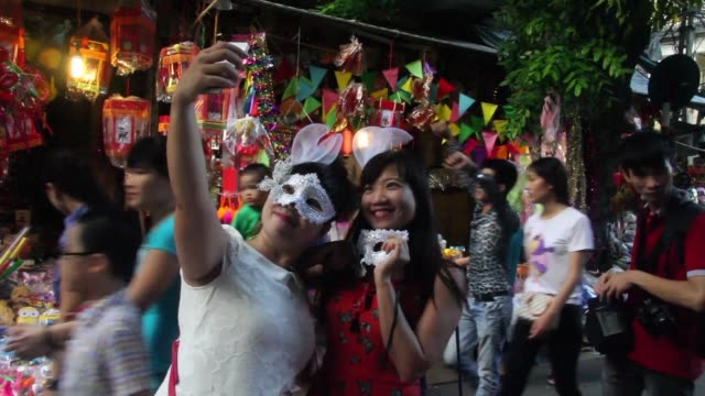 papier mache masks are part of traditional vietnamese celebrations for the mid autumn festival but cheap chinese toys are threatening the tradition - papier 個影片檔及 b 捲影像