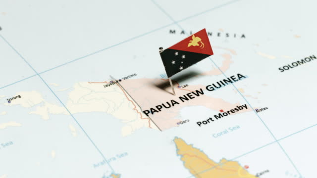 papua new guinea wit national flag - papua stock videos and b-roll footage