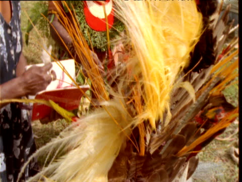 papuan villagers prepare feather headdress for mount hagen show, papua new guinea - headdress stock videos & royalty-free footage