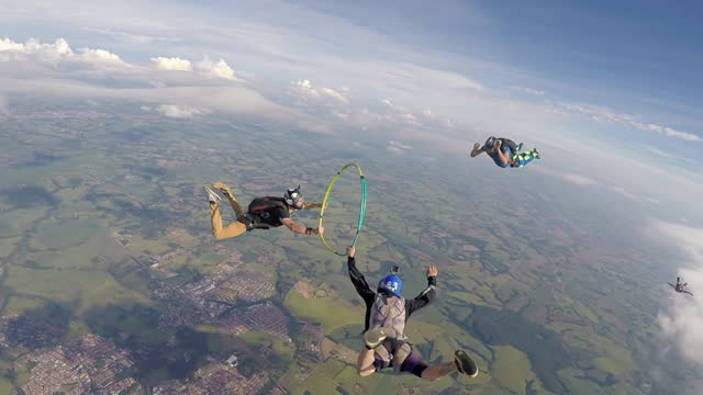 a parachute jump with the hula hoop - high up stock videos & royalty-free footage