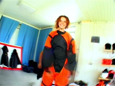 parachute jumps. a fanny girl wearing special costume - parachuting bildbanksvideor och videomaterial från bakom kulisserna
