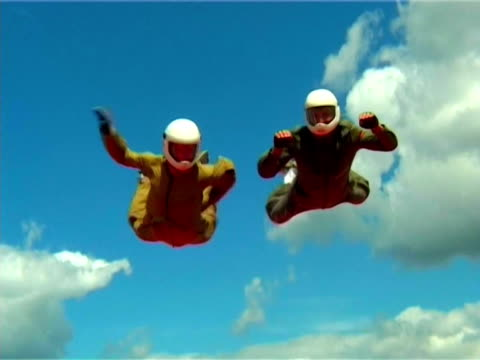 parachute jump.two men hovering over the land - hovering stock videos & royalty-free footage