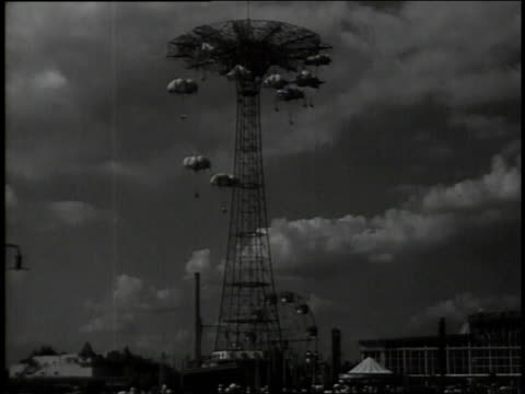 1947 montage parachute ride at coney island / new york, new york, united states - coney island stock-videos und b-roll-filmmaterial