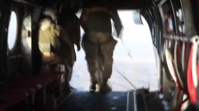 parachute riggers with 1st air delivery platoon landing support company combat logistics regiment15 conduct 1500 foot staticline jumps out of ch46... - para state stock videos & royalty-free footage