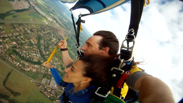 parachute tandem flying - paragliding stock videos & royalty-free footage