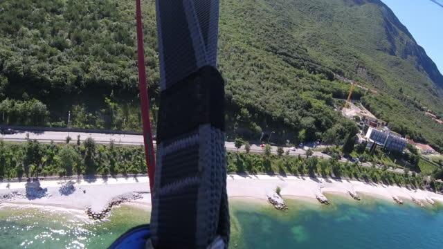 Parachuter landing on beach