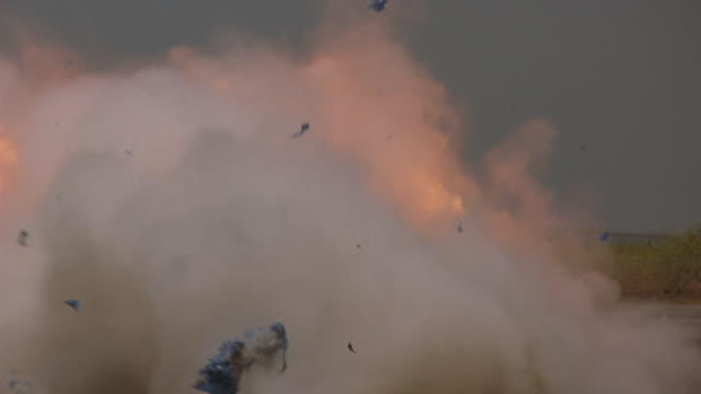 Parachutes exploding on the ground.