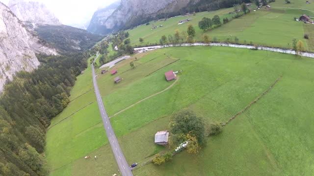 pov parachuting after base jump landing in farmers field - fallschirm stock-videos und b-roll-filmmaterial