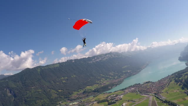 parachuting over alps - air to air shot stock videos & royalty-free footage