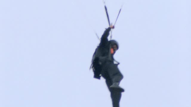 a parachutist jumping off from a helicopter. - us navy stock videos & royalty-free footage