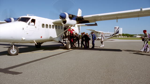 Parachutists lining up to enter airplane
