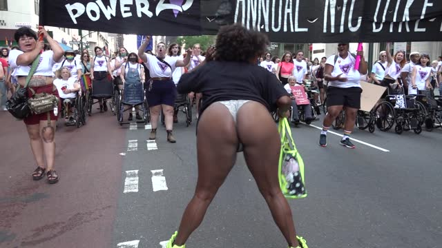 parade attendee twerks in front of the banner during the 29th annual dyke march celebrating lgbtq pride on june 26 in new york city. the march, the... - azul stock videos & royalty-free footage