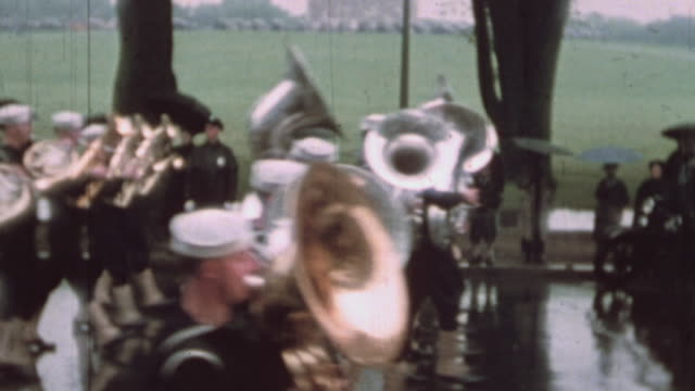 parade featuring children marching bands playing musical instruments safety bicycle club members during rainy weather / washington district of... - banda che marcia video stock e b–roll
