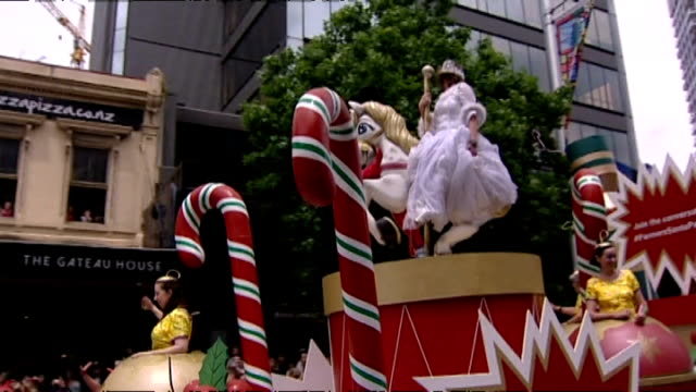 parade float adorned with decorations and princess at annual farmers santa parade along queen street in auckland - festwagen stock-videos und b-roll-filmmaterial
