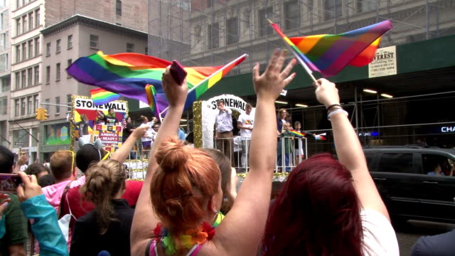 parade float commemorating the stonewall riots moves down 5th avenue, as several million onlookers gather at the annual gay pride parade in new york... - parade stock videos & royalty-free footage