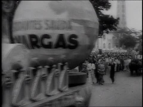 MONTAGE parade floats going down a city street / Rio De Janeiro Brazil