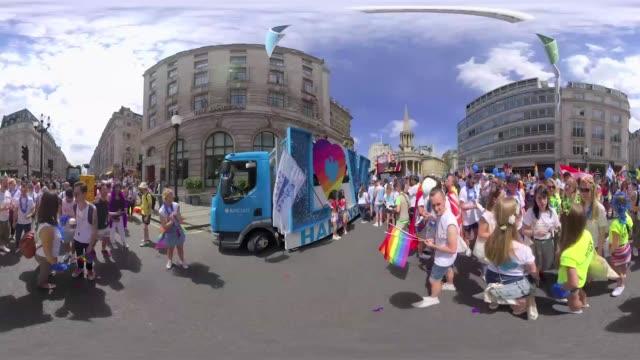 Parade floats pass through the street of Langham Palace road