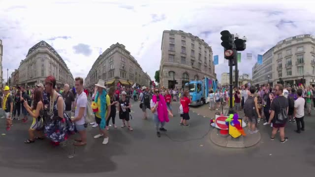 Parade floats pass through the street of London during Pride
