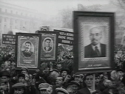 parade in bulgaria, crowd holding lenin and stalin posters leaders waving from tribune audio / bulgaria - anno 1952 video stock e b–roll