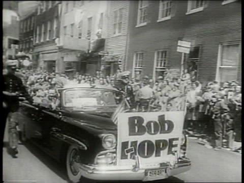parade in celebration of the 22nd shenandoah apple blossom festival / float goes by on the street surrounded by onlookers / grand marshall bob hope... - festival float stock videos & royalty-free footage