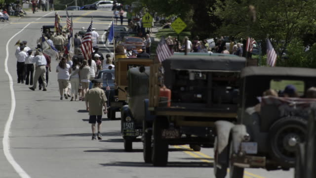 parade in small town with long row of antique cas, flags, boy scounts, military, marching band, and crowds. smalltown americana. - boy scout stock videos and b-roll footage