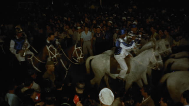 ws parade of band riding horses / unspecified - marching band stock videos and b-roll footage