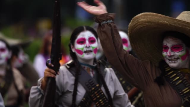 parade of day of the dead celebrated in reforma avenue on october 28 2017 in mexico city mexico the religious syncretism which combines catholic and... - paganism stock videos and b-roll footage