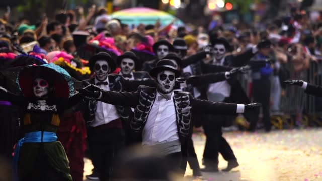 parade of day of the dead celebrated in reforma avenue on october 28, 2017 in mexico city, mexico. the religious syncretism which combines catholic... - parade stock videos & royalty-free footage