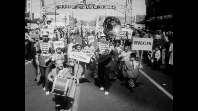 vídeos y material grabado en eventos de stock de / parade of little people / banner above door reads 'riverside welcomes midgets of america if you want anything just whistle' / little people check... - 1957
