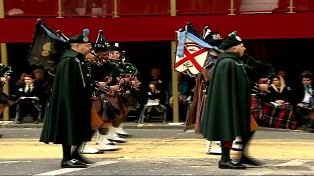 Parade of Mayors through London Bagpipe band along/ Vinatage cars along in parade