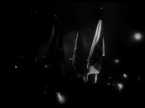 parade of nazis carrying flags + torches at night / hitler just appointed chancellor - 1933 stock-videos und b-roll-filmmaterial