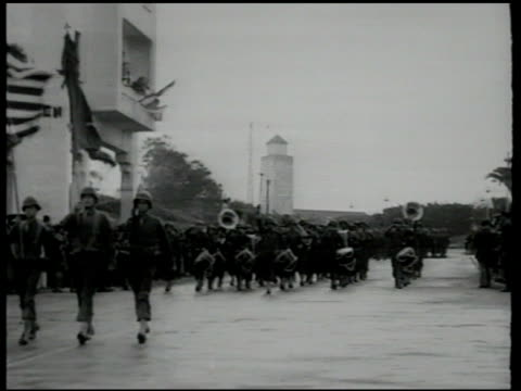 parade of soldiers, color guard, military band. general george s. patton standing next to pro-vichy french resident general charles nogues on... - 1942 stock videos & royalty-free footage
