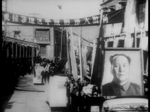 a parade of tibetans celebrating the victory of china over the rebels of tibet - 1959 stock-videos und b-roll-filmmaterial