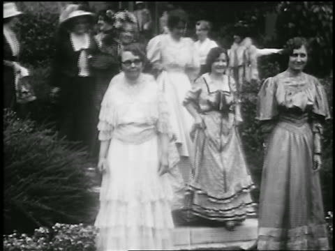 b/w 1929 parade of women in 19th century dress / pasadena, california / newsreel - pasadena california stock videos & royalty-free footage