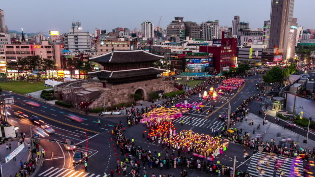 parade on buddha's birthday event on street at dongdaemun(major eastern gate in the wall that surrounded seoul during the joseon dynasty) - buddha's birthday stock videos and b-roll footage