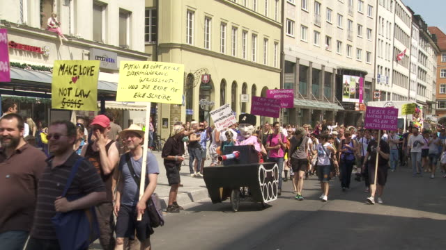 parade on christopher street day munich 2013 - wladimir putin stock-videos und b-roll-filmmaterial