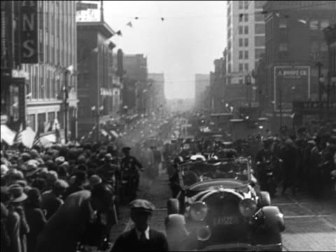 b/w 1928 parade on crowded omaha street during al smith's campaign / documentary - nebraska stock-videos und b-roll-filmmaterial