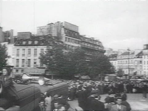parade on paris boulevard republique square communists marching maurice thorez sitting on tribune audio / paris, france - anno 1952 video stock e b–roll