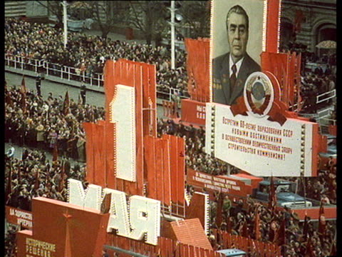 vídeos de stock e filmes b-roll de parade on red square may 1 brezhnev alone saluting from mausoleum tribune huge crowd cheering brezhnev and cpsu party leaders saluting at tribune... - leonid brezhnev