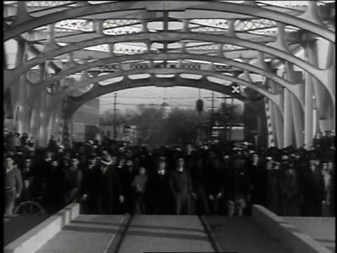 stockvideo's en b-roll-footage met parade over the new bridge / crowd of people waving as part of the bridge's road surface raises - 1935
