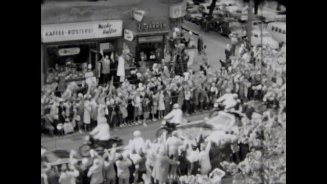 parade through west berlin privately filmed from a balcony many motorcycle policemen passing then the open car with john f kennedy as president of... - westberlin stock-videos und b-roll-filmmaterial