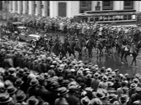 parade up broadway w/ many people lining street, convertible w/ queen marie of romania waving to crowd, mayor jimmy walker walking down city hall... - 1926 stock videos & royalty-free footage