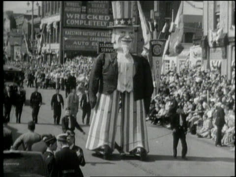 a parade with an uncle sam parade float celebrates franklin d roosevelt's inauguration day in 1941 - uncle sam stock videos & royalty-free footage
