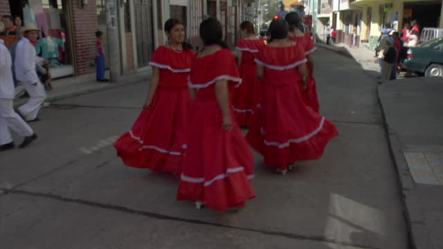 ws parade with dancers and fire trucks, ecuador - ecuador stock videos and b-roll footage