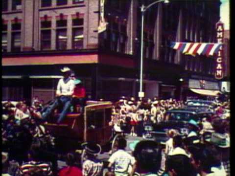 1953 ws parade with native american teepee and girl riding horse with cowboy hat, rodeo, with cowboy riding bucking bronco, and then another riding bull / usa / audio - arbeitstier stock-videos und b-roll-filmmaterial